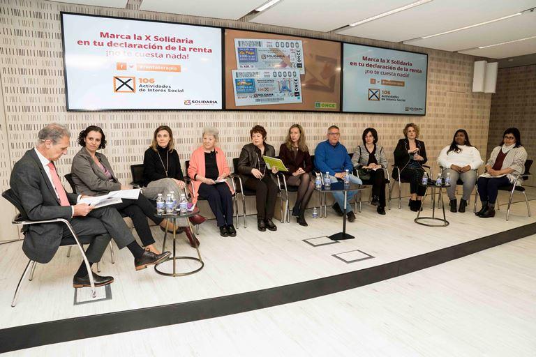 encuentro informativo celebrado en el Auditorio de Torre ILUNION, en Madrid, en el que se abordó la importancia de animar a la ciudadanía a marcar la 'X Solidaria'
